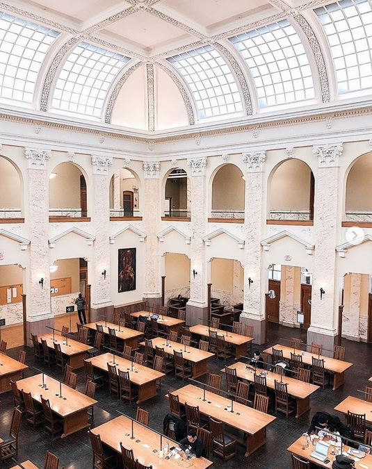 people studying at tables in large room at Carnegie Library