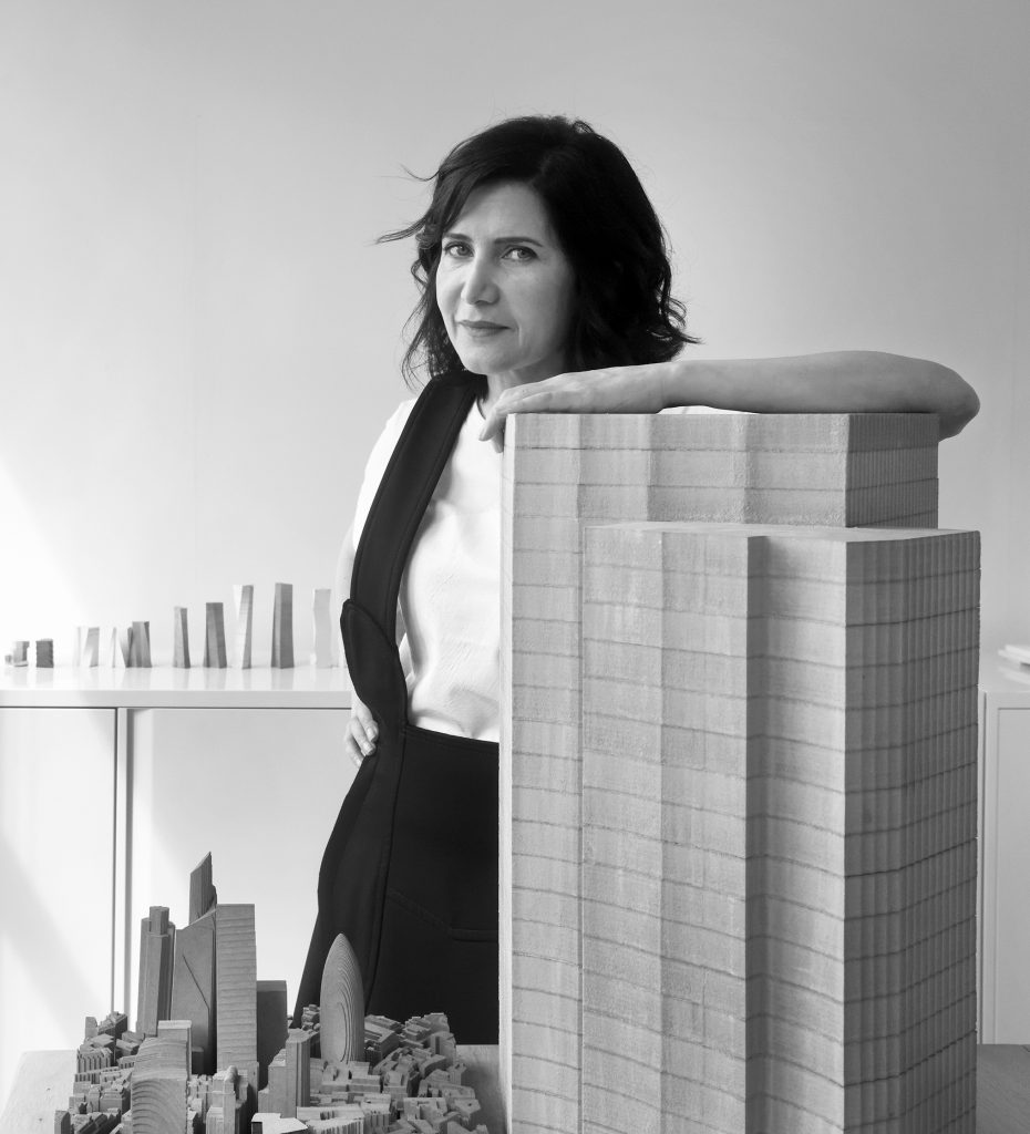 woman standing amid architectural constructs