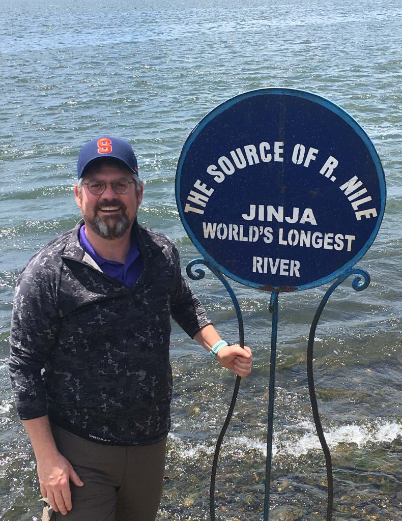 Tucker at the point where Lake Victoria becomes the Nile River, in Jinja, Uganda, in March 2018.