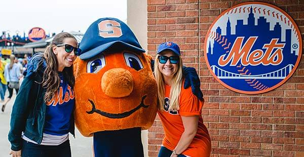 two fans with Otto the Orange