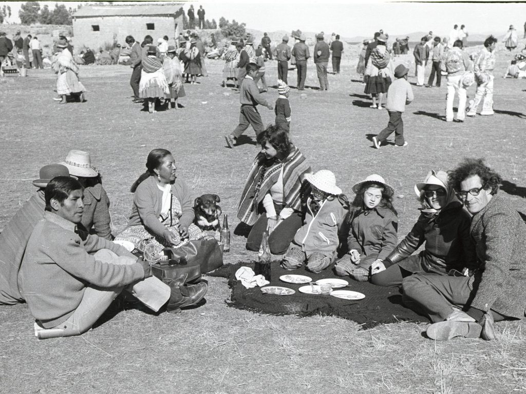 Old photo of people sitting together in a field