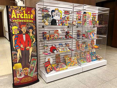 Display case in Bird Library filled with Archie Comics items