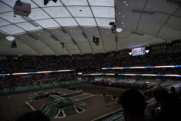 view from the stands of monster trucks on the Dome floor