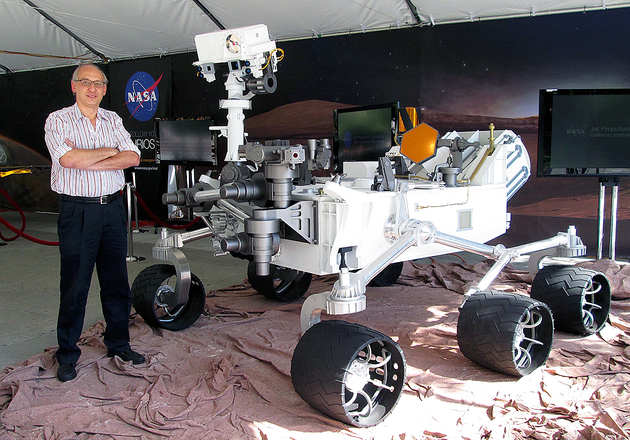 man standing with Mars rover