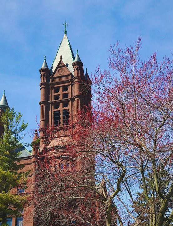 Crouse College spires with trees in front