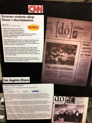 display of newspaper clippings and photos