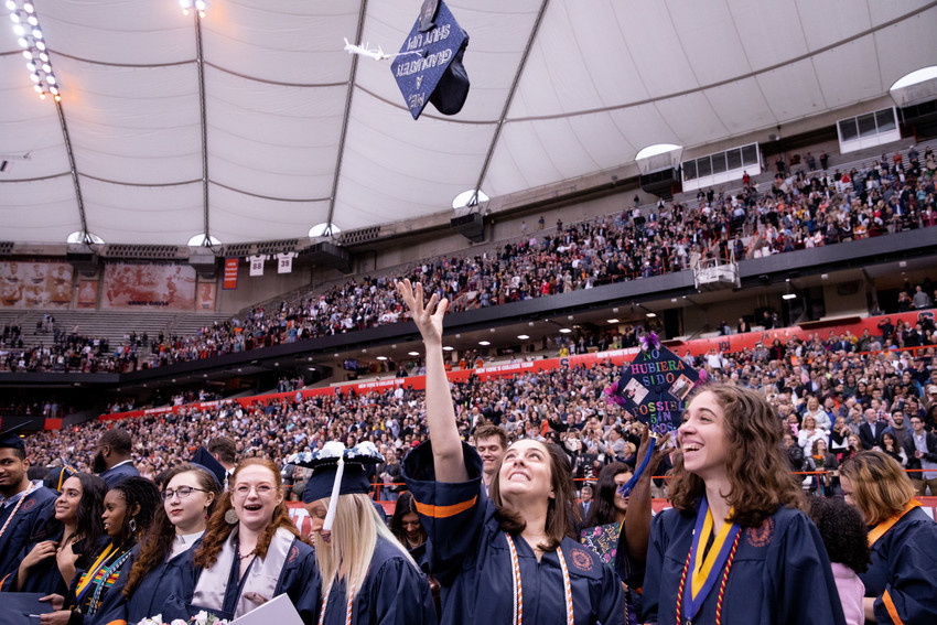 woman tossing her cap during graduation