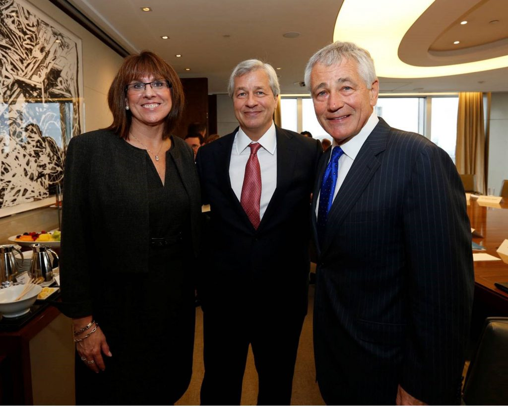woman and two men in business suits