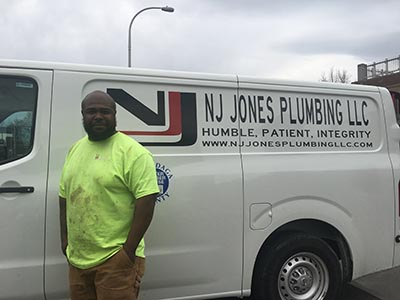 NaDonte Jones with service truck