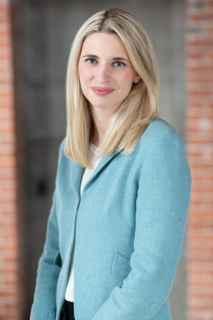 blonde woman in a business suit