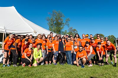 group of Syracuse University employees in orange shirts