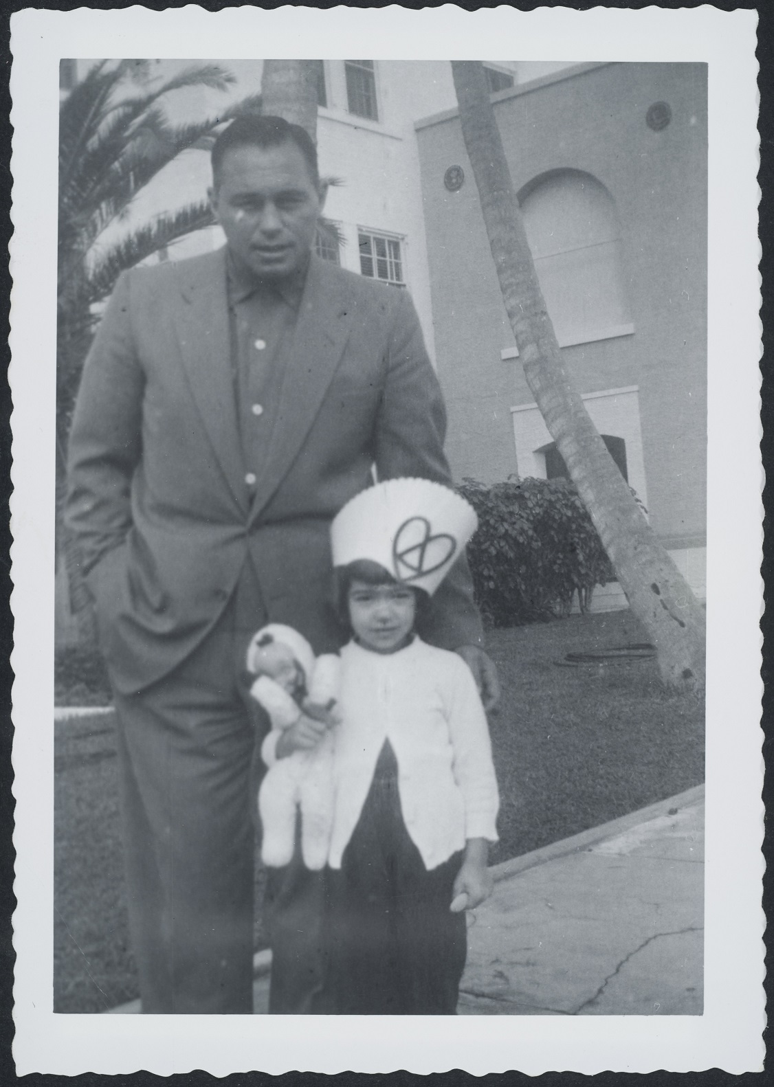 man and young girl standing outside