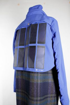 Jacket with solar panels sewn into its back