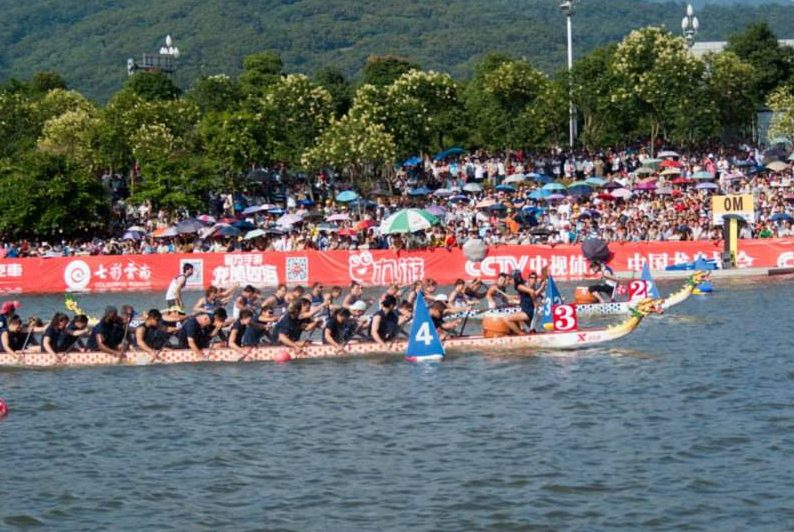 dragon boats in water at race