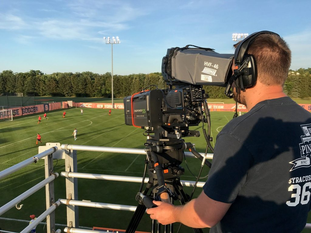Cameraman overlooking the soccer pitch.