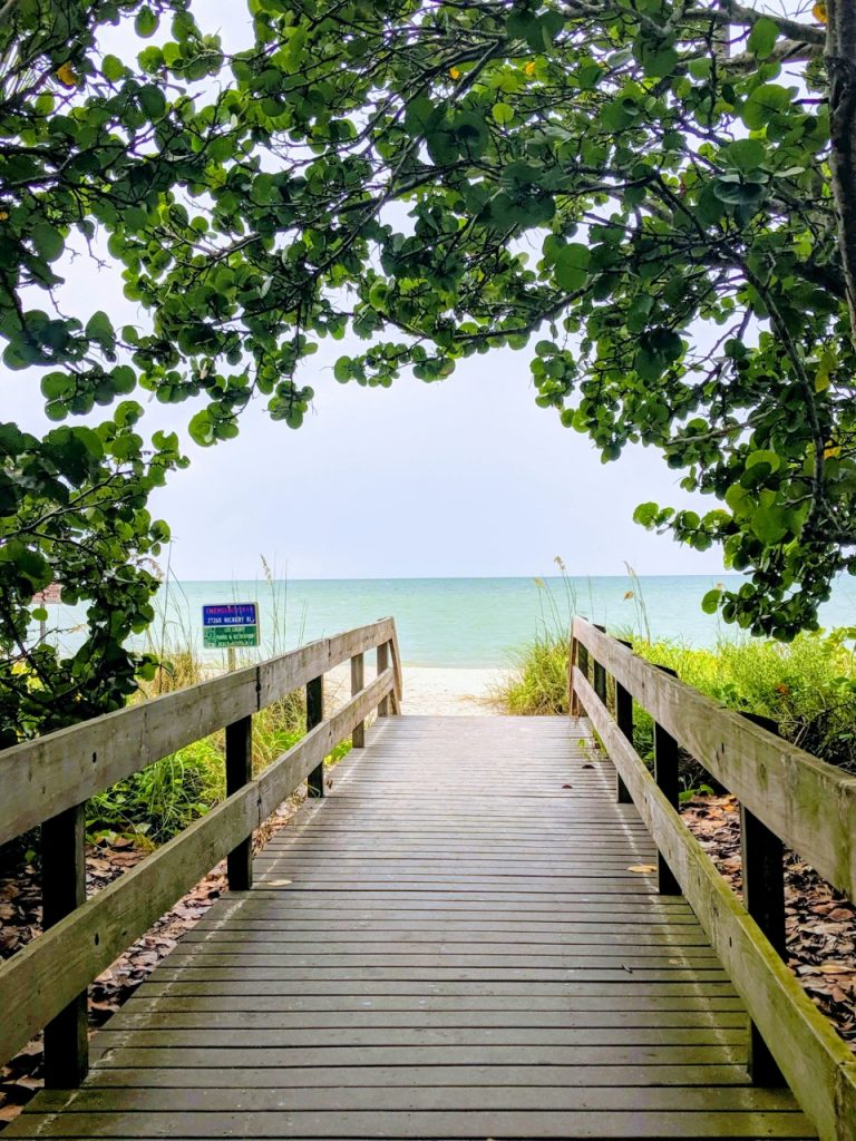 Wooden walkway leading to a beach.