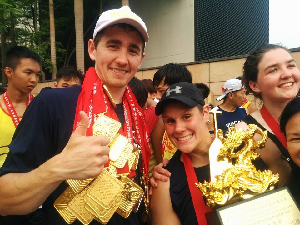man and woman with medals around their necks