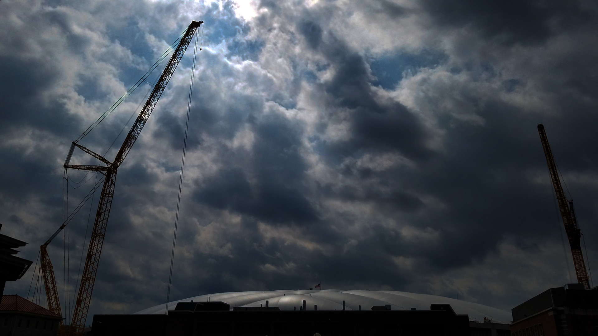 two cranes hover over Dome