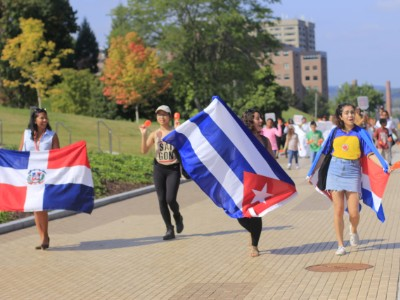 Students marching with flags