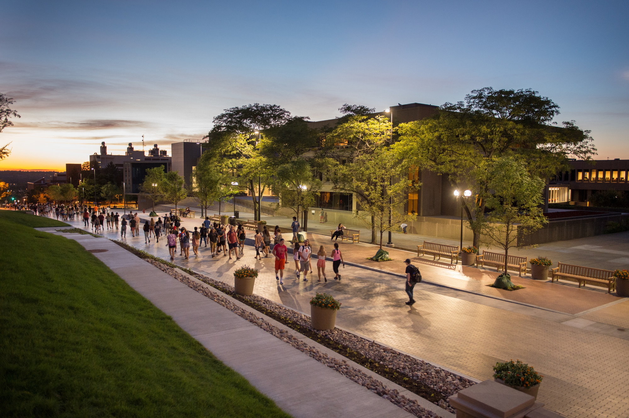 Students walking at night along the Einhorn Family Walk.