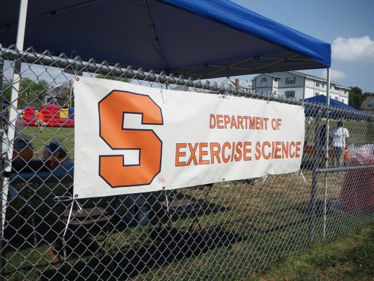Department of Exercise Science banner hangs on fence