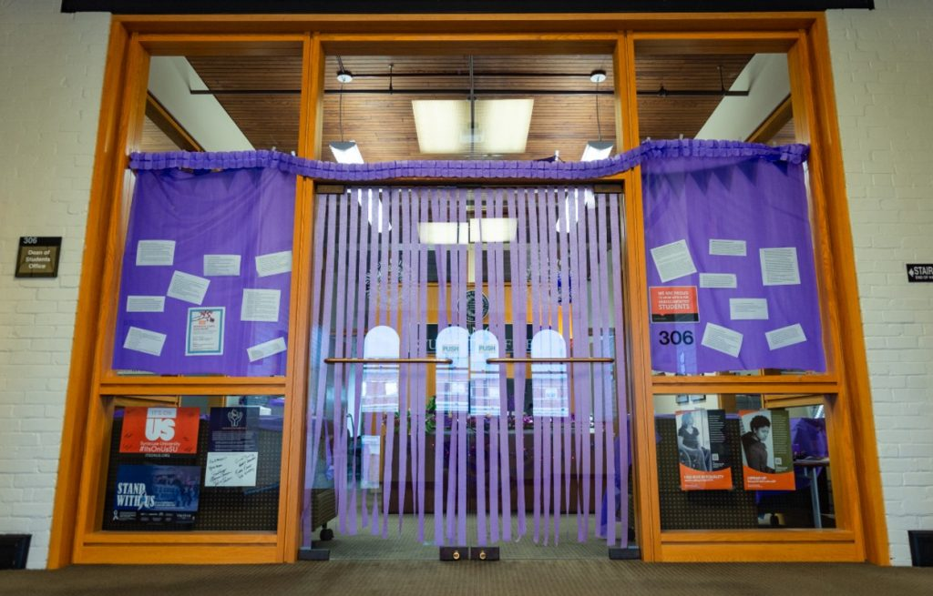 entryway decorated with purple curtains and streamers