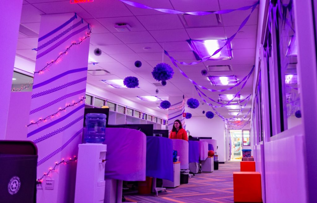 office space illuminated with purple lights and decor