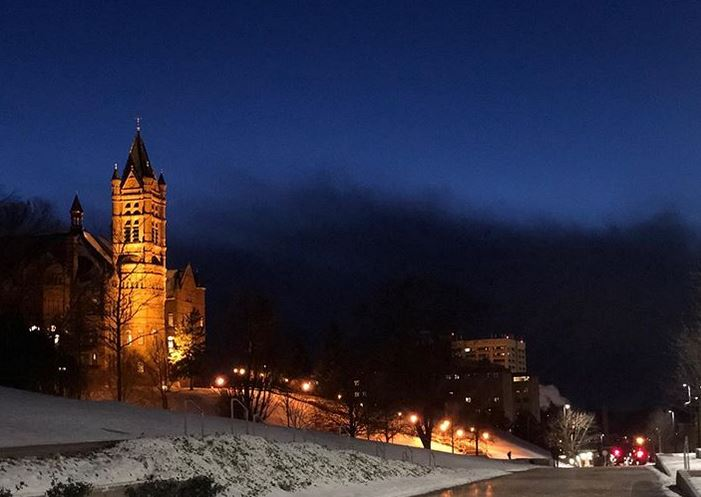 Crouse College lit up at night