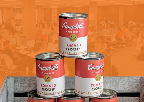 Three cans of Campbell's Tomato Soup.