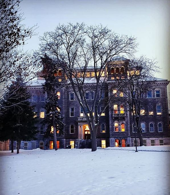 snow in grass in front of Smith Hall