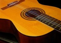 A close up of an acoustic guitar.