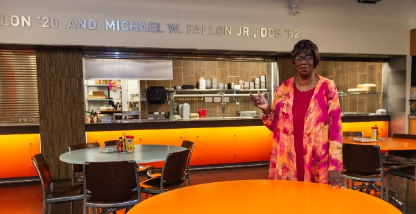Gerri Williams poses near cafeteria