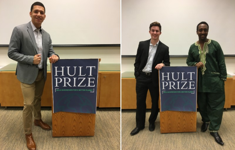 students pose at Hult Prize podium