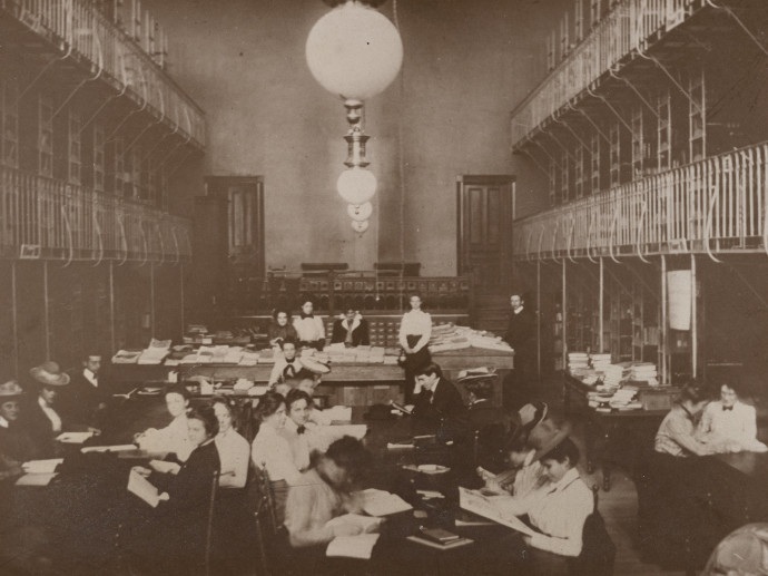 old photo of people in library