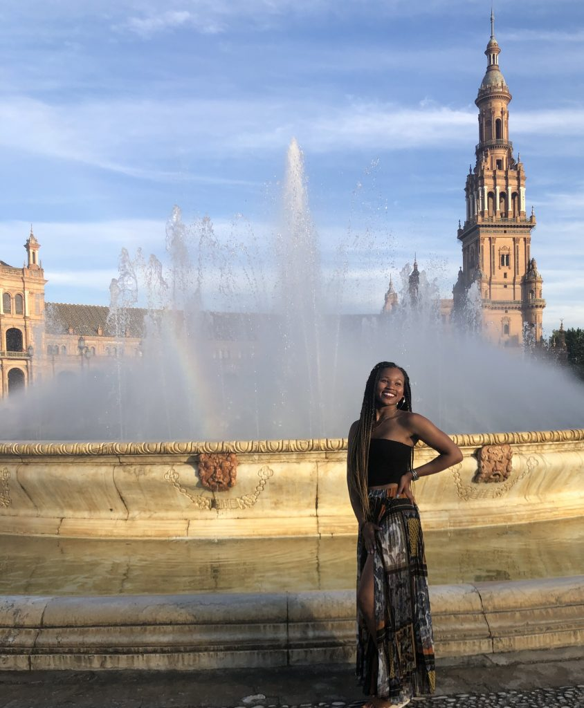 woman standing in front of fountain