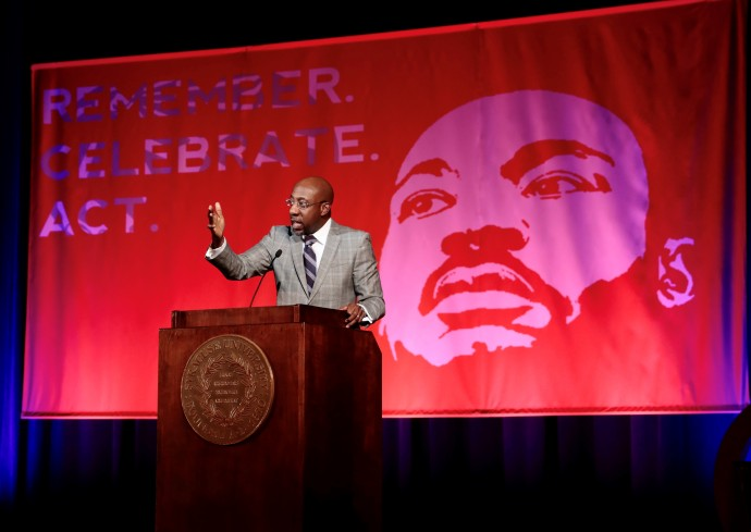 Rev. Raphael Warnock speaks at podium