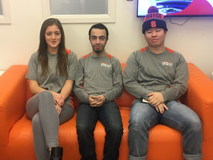 three people sitting on couch