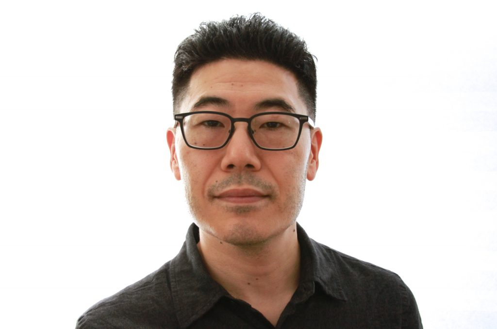 headshot of Corey Takahashi