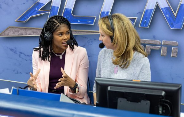 two female sportscasters wearing headsets