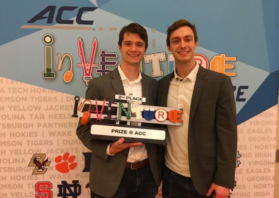 Quinn King and Alec Gillinder pose with 2019 competition prize
