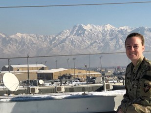 soldier in front of mountains