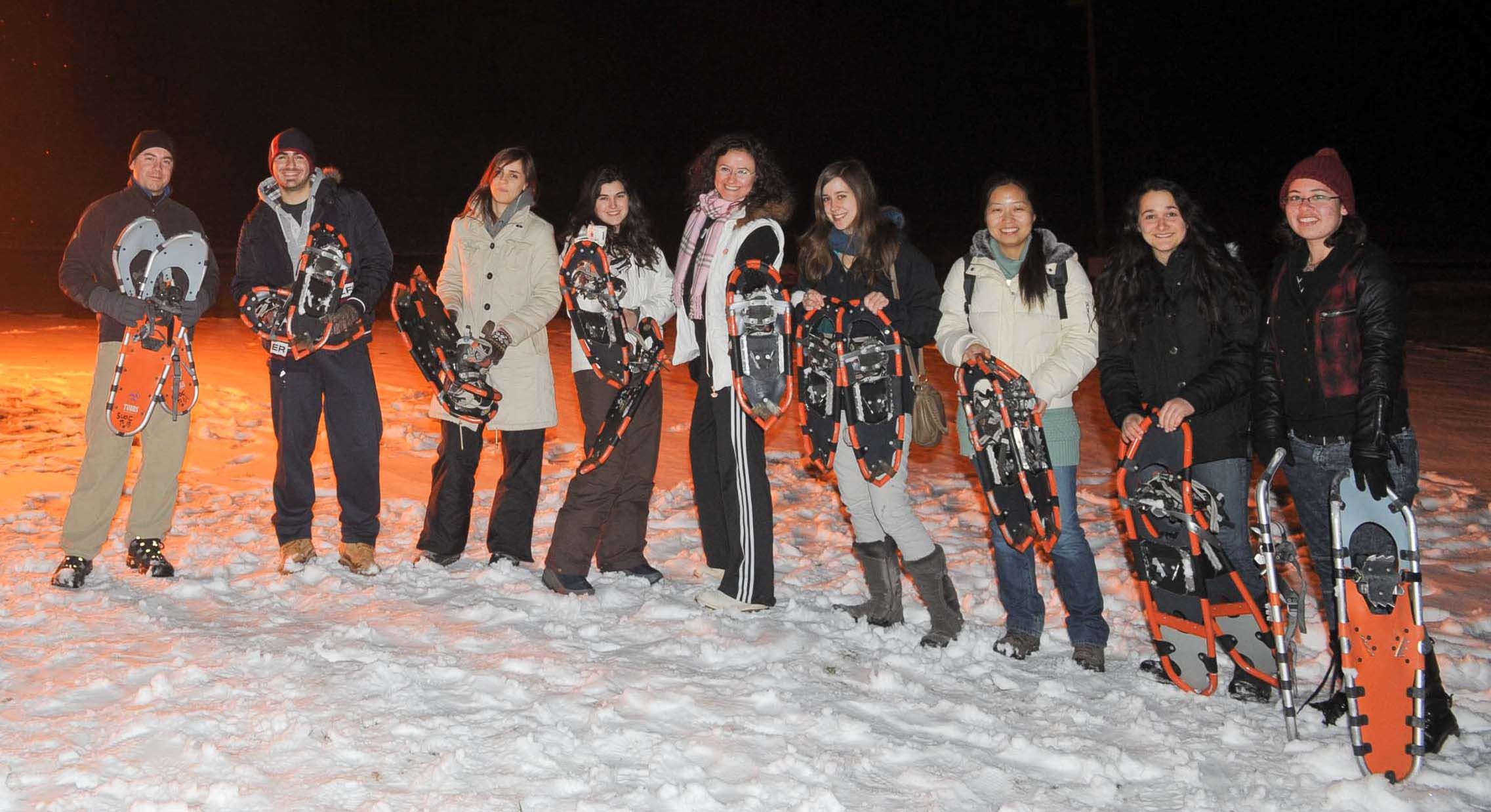 Group of students posing with snowshoes