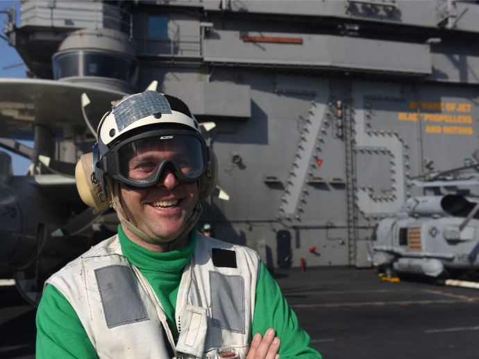 person on deck of navy ship