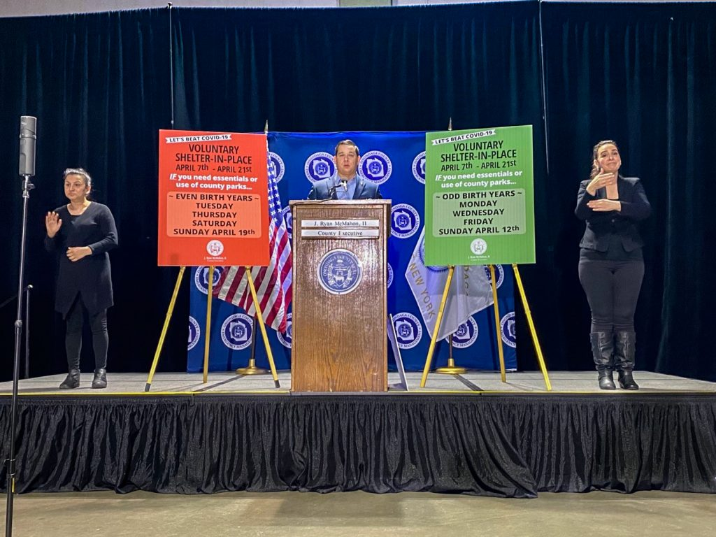 Covid-19 press conference featuring Onondaga County Executive Ryan McMahon, with American Sign Language interpreters on either side.