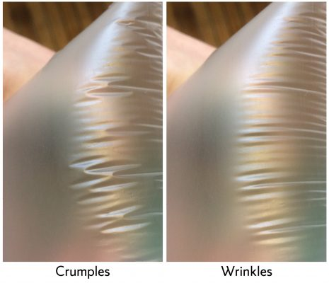 depiction of crumples vs wrinkles in a sheet of plastic