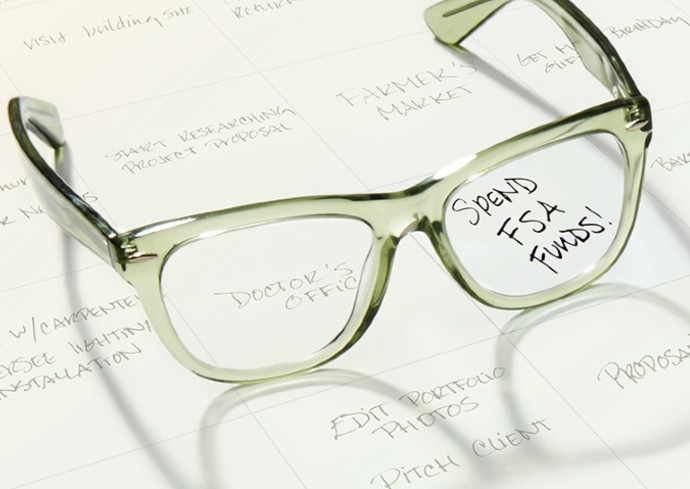 stock image of glasses on a calendar with Spend FSA Funds as an entry