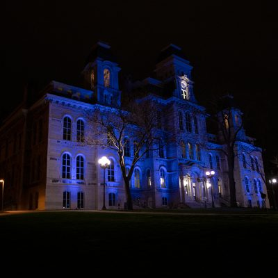 Hendricks Chapel bathed in blue