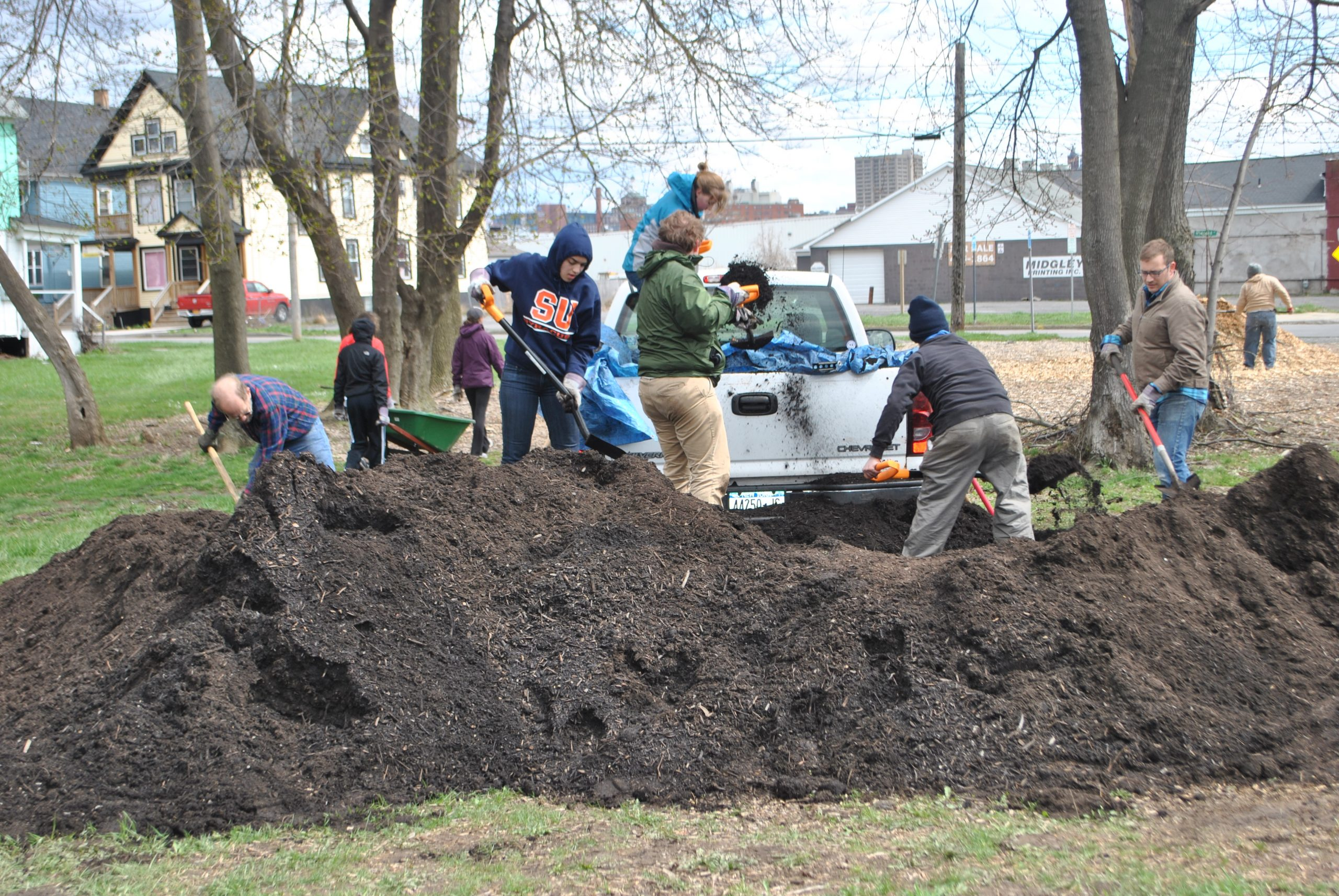 people working in compost pile