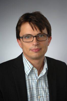 portrait of Chris Foster, associate professor of English
