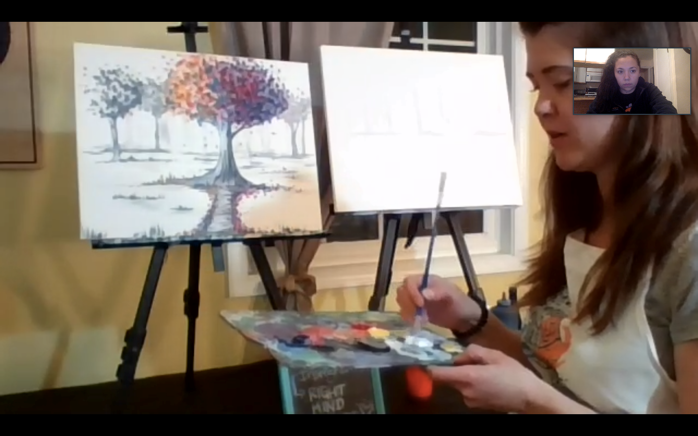 Artist with a paint brush and canvas